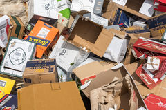 Stack of used cardboard boxes in the street Royalty Free Stock Photos