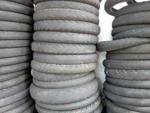 A stack of used motorcycle tyre. A stack of motorcycle tyre at a workshop. Used tyre can be recycle Royalty Free Stock Image