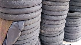 A stack of used motorcycle tyre. A stack of motorcycle tyre at a workshop. Used tyre can be recycle Royalty Free Stock Photography