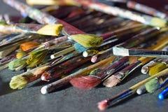Stack of used paintbrushes Stock Photo