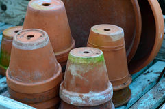 Stack of used terra-cotta flower pots Royalty Free Stock Photo