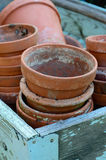 Stack of used terra-cotta flower pots Stock Photo