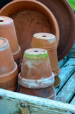 Stack of used terra-cotta flower pots Royalty Free Stock Image
