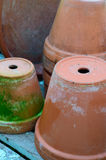 Stack of used terra-cotta flower pots Stock Images