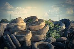 Stack of used tires outdoor. Stack of used tires in Houston, Texas, USA. Pile of  scrap, old rotten rubber tires near a construction site ready for cut tire Royalty Free Stock Photo