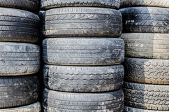 Stack of used tries that from truck and cars Royalty Free Stock Image