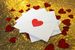 Stack of Valentine`s Day Love Letters on Gold Background with He Royalty Free Stock Images