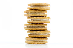 Stack of vanilla cookies with cream filling on white background. Stack of six vanilla cookies with cream filling on white background Royalty Free Stock Photo