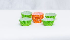 Stack of a variety of colorful cupcake liners Stock Images