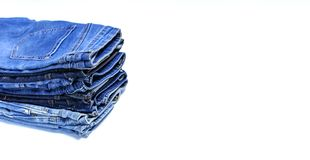 Stack of various blue jeans on white background. Beauty and fashion, clothing concept. Detail of nice blue jeans. Jeans texture or stock images