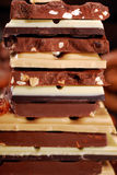 Stack of various chocolate bars Stock Images