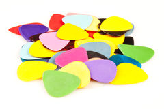 A stack of various color guitar picks Stock Photos