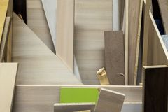 Stack of various construction supplies samples. Insulation foams and wood boards stock images