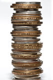 Stack of various denominations of coins Stock Photo