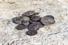 Some Greek metal ancient coins. Stack of various Greek ancient coins above stone background, Athens, Greece stock photos