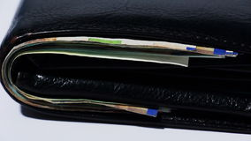 Stack of various of israeli shekel money bills in close black leather wallet - Tilt Down stock footage
