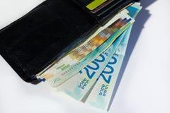 Stack of various of israeli shekel money bills in open black lea Stock Photography