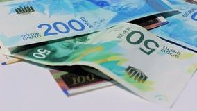 Stack of various of israeli shekel money bills - Tilt down stock video