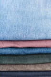 Stack of various jeans close up Stock Photo
