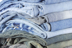 Stack of various jeans Stock Images