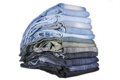 Stack of various jeans isolated Stock Image