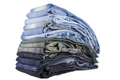 Stack of various jeans isolated Royalty Free Stock Photography