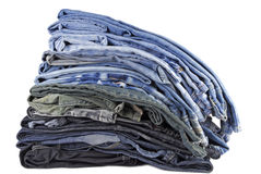 Stack of various jeans isolated Royalty Free Stock Image