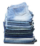 Isolated Jeans Stack. A stack of various pairs of jeans pants isolated on white background Stock Photography
