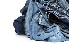 Stack of various shades of blue jeans stock image