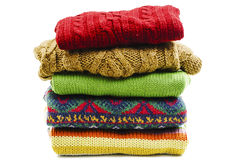 Stack of various sweaters. Winter style Royalty Free Stock Images