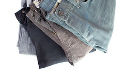 Stack of verious denim clothes isolated Stock Photo