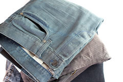 Stack of verious denim clothes  Stock Images