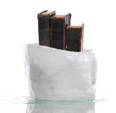 Stack of very old prayer books captured in ice Stock Photo