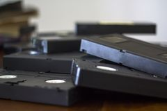 Stack of vhs cassette tapes. Stack of old vhs cassette tapes stock photography