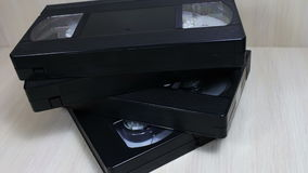 Stack of VHS video tape cassette. Female hand touches stack of VHS video tape cassette stock video footage