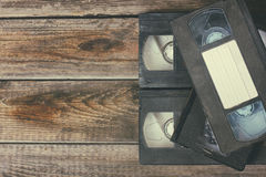 Stack of VHS video tape cassette over wooden background. top view photo Stock Photography