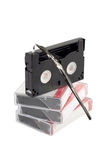 Stack of videocassettes. A stack of videocassettes on white Stock Image