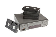 Stack of videotapes on videorecorder isolated on white background Royalty Free Stock Photography