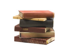 Stack of vintage books. Uneven pile o old books isolated on white Royalty Free Stock Photography
