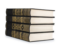 Stack of vintage books black with gold pattern Royalty Free Stock Photo