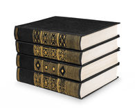 Stack of vintage books black with gold pattern Stock Photo
