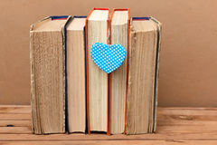 Stack of vintage books with heart shape Stock Photos
