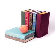 Stack of vintage books with peach Royalty Free Stock Photo