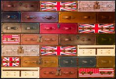 English-style suitcases texture. Stack of vintage English-style suitcases wallpaper. Numerous leather travelling bags form a brickwork pattern Royalty Free Stock Images