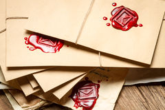 Stack of vintage envelopes with red sealant Royalty Free Stock Photo
