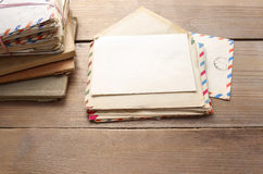 Stack of vintage letters on wooden table royalty free stock images
