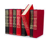 Stack of vintage red and black books with gold ornament Royalty Free Stock Photography