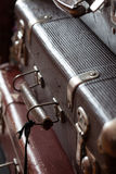 Stack of vintage retro suitcases closeup. Stack vintage leather suitcases closeup still life Stock Photos