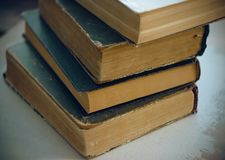 Stack vintage encyclopedias in the dark cover stock photography