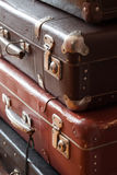 Stack of vintage suitcases closeup still life Stock Photos